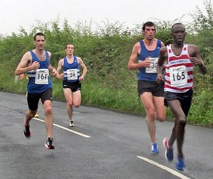 Abraham Tewelde chased by a trio of Morpeth Harriers